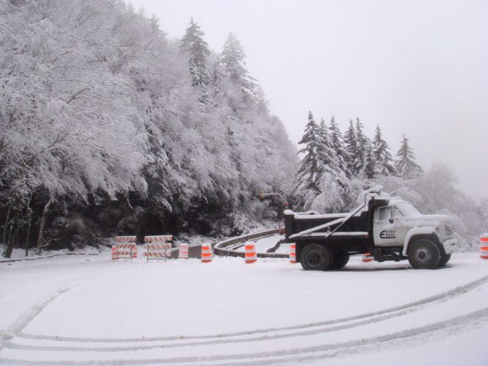 Construction company working on rejuvenating a road in the Great Smoky Mountains National Park in winter snow