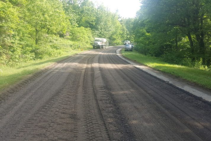 Construction company resurfacing a section of the Blue Ridge Parkway in Boone