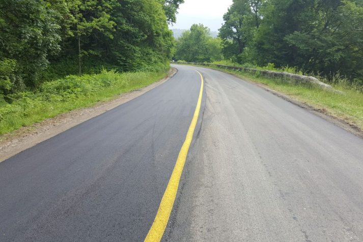 Construction company showing the differences in the previous surface and that of the freshly paved surface