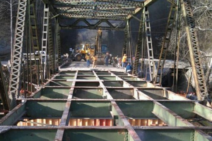 Construction company working on placing the metal lattice base for a bridge in Hiltons, VA