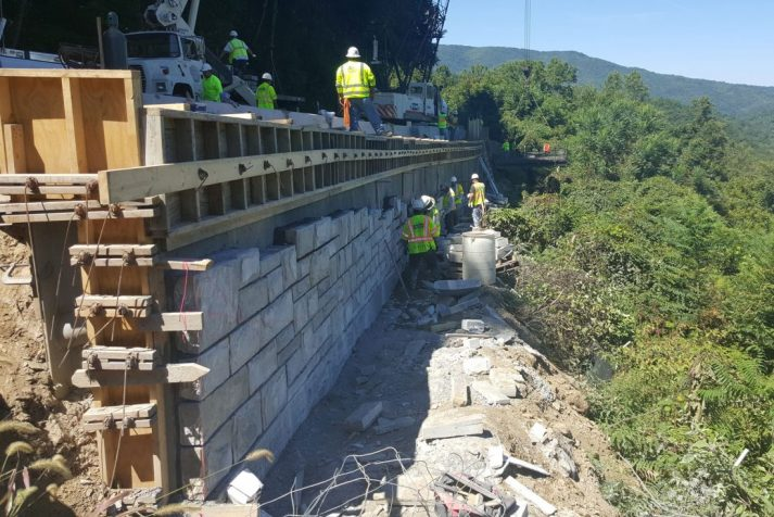 Construction workers doing various tasks for rehabilitation on section of Newfound Gap Road