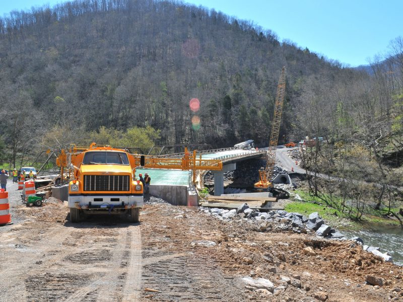 Construction company finishing up a multiple support bridge across the clinch river