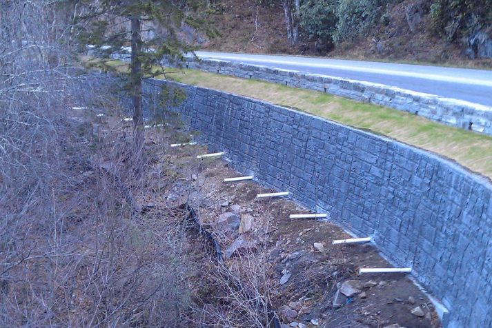 Construction company showing finished retaining wall and drainage pipes for Great Smoky Mountains National Park