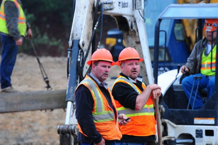 A pair of supervisors observing the job of their construction workers at the Bear Creek Dam