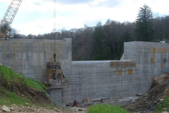 Construction company showing their dam (without water) from their completed Big Cherry Project