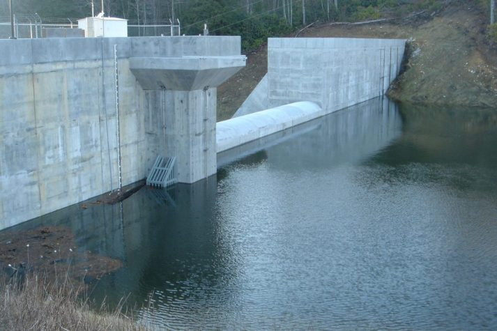 Construction company showing their finished dam in use from the Big Cherry Project