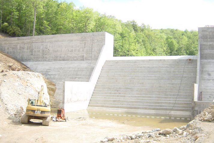 Construction company showing their finished concrete dam from the Big Cherry Project