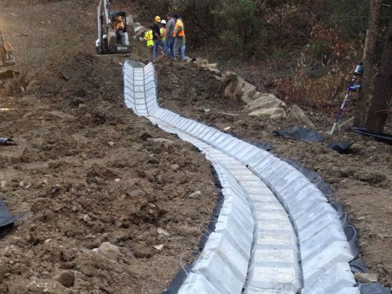 Construction company works on installing a permanent drainage line at Penhook DMME